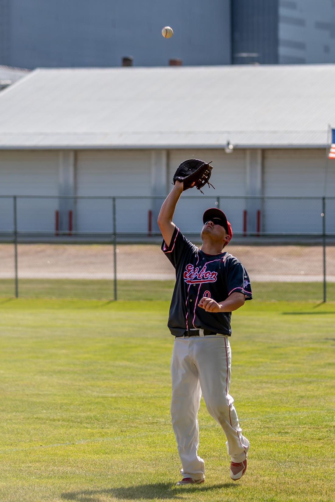 First baseman Kyle Maurer catches a pop-fly.