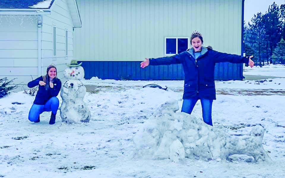 The Snow Sculpture Contest had some great entries this year.  Gibbon Royalty Rylee Sabo and Baleigh Peterson are pictured with the various creations. This sculpture was the second place winner.