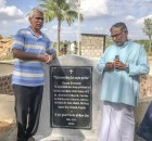 Father Bruno and Father Stephen from India explaining how the well was built and showing the stone memorial thanking the parishes for their support.
