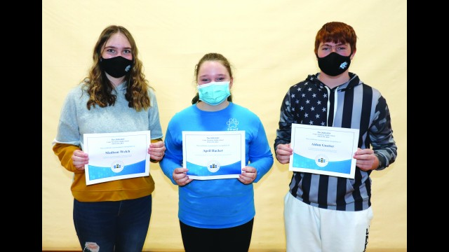 Cedar Mountain held their annual spelling bee last week. The first-place winner was April Hacker (center). Madison Welch (left) placed second and Aidan Guetter (right) placed third.